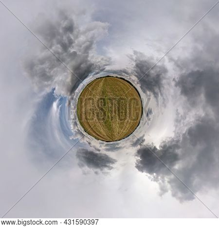 Tiny Planet In Blue Sky With Beautiful Clouds. Transformation Of Spherical Panorama 360 Degrees. Sph
