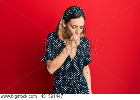 Young caucasian blonde woman wearing beautiful black and white dress feeling unwell and coughing as symptom for cold or bronchitis. health care concept.