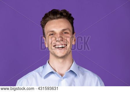 Caucasian Young Mans Portrait Isolated On Purple Color Studio Background. Concept Of Human Emotion,