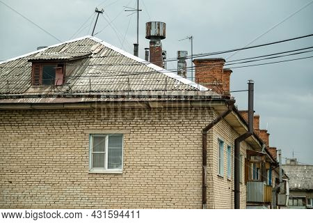 View Of The Roof Of Old Brick House With Chimneys And Lots Of Tv Antennas