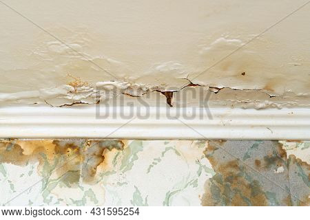 Cracked Plaster On The Ceiling After A Water Leak From The Upper Floor