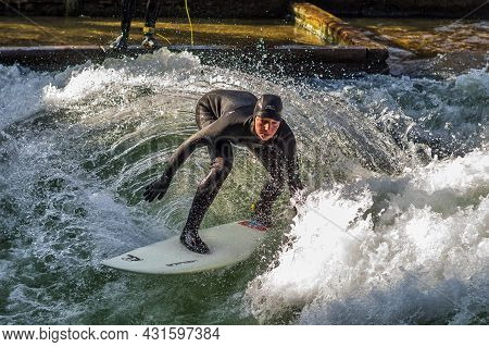 Munich, Germany - December 13, 2020: Winter Surfer In The City River, Munich Is Famous For People Su