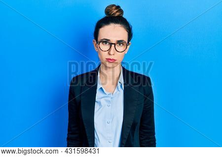 Young hispanic girl wearing business clothes and glasses depressed and worry for distress, crying angry and afraid. sad expression.