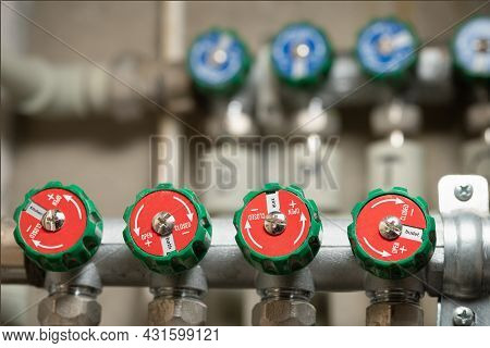 Plumbing Regulating Collector Of Water Supply In The Appartment With Round Taps