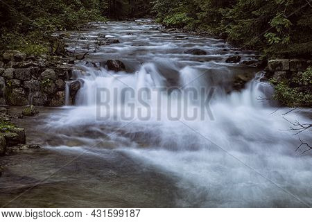 Flowing Creek, Western Tatras Mountain, Slovak Republic. Seasonal Natural Scene. Long Time Photo Exp