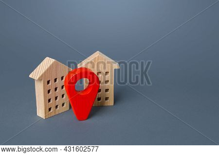Red Location Pin And Houses. Location Concept, Settlement. Tracking, Internet Of Things. City Naviga