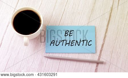 Be Authentic Text On Blue Sticker With Cofee And Pen