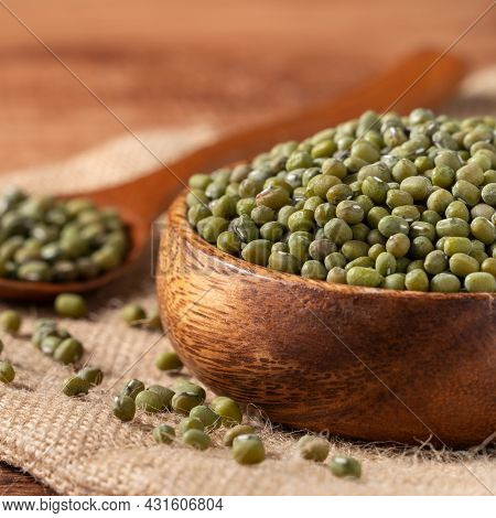 Close Up Of Raw Mung Bean On Wooden Table Background.
