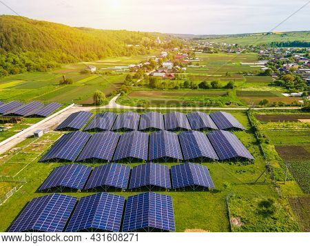 Aerial View Of Large Sustainable Electrical Power Plant With Rows Of Solar Photovoltaic Panels For P