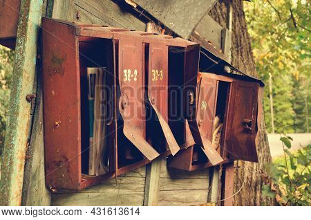 Vintage background. Opened old rusty metal mailboxes - shallow depth of field, vintage filter processing