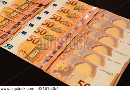 Winning The Lottery, Euro On A Black Background, Texture Of Money.