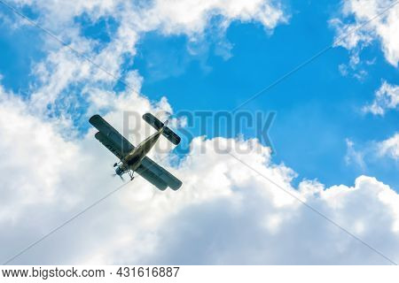 Beautiful Biplane In Flight On A Cloudy Sky. Air Transport. Sport. Agriculture. Transport.