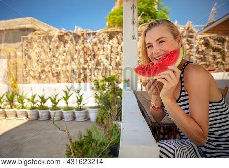 Pretty Girl with Pleasure Eating Ripe Fresh Juicy Watermelon. Enjoying Tasty Sweet Summertime Fruits. Enjoying Beach House. Happy Summer Vacation.