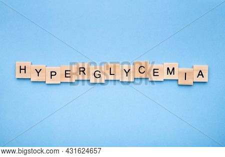 Word 'hyperglycemia' on wooden blocks on blue background