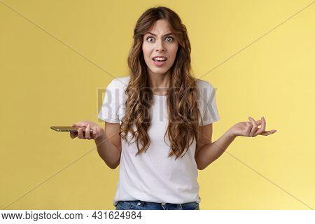 Pissed Frustrated Bothered Curly-haired Caucasian Girl Stare Camera Puzzled Complain Hold Smartphone