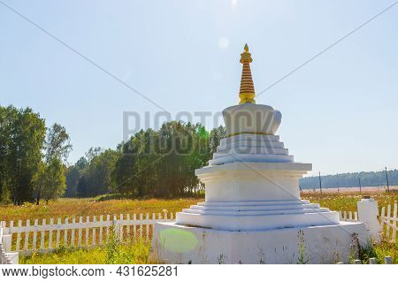 White Buddhist Stupa Of An Enlightenment With Sun Glare At Summer Day. Buddhist Faith In Siberia. Sa
