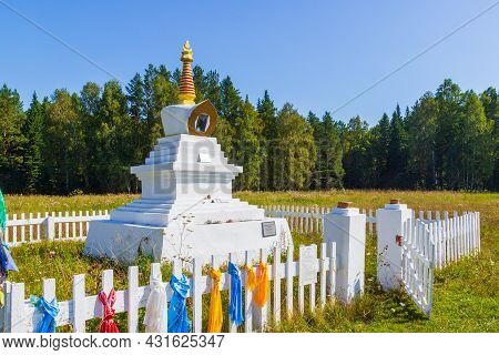 Summer View On White Buddhist Stupa Of An Enlightenment Decorated With Colorful Buddhist Prayer Scar