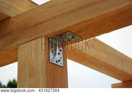 A Frame Of A House Against A Blue Sky. The Frame Of The Cottage. The Beginning Of The Construction O