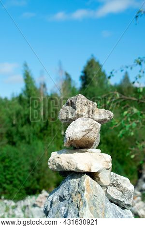Stone Cairn In Ruskeala Park, Karelia, On A Sunny Day. Stack Of Stones Indicating The Right Way. Bal