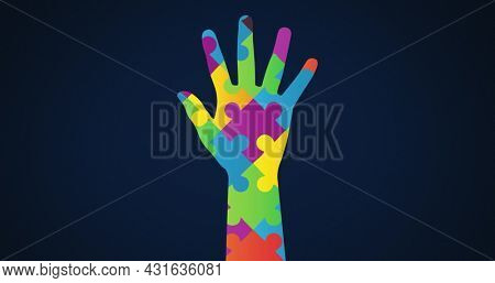 Image of multi coloured puzzle elements forming hand, symbol of Autism Awareness Month symbol on blue background. Autism awareness support concept digitally generated image.