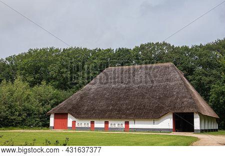 Genk, Belgium - August 11, 2021: Domein Bokrijk. Giant Barn Of Zuienkerke With Large Straw Roof, Whi