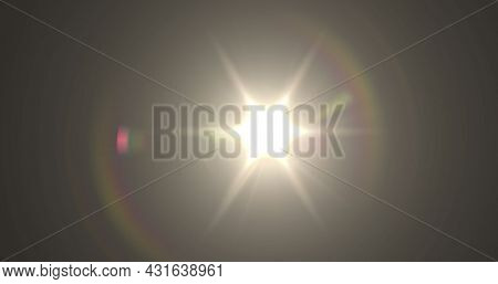 Image of glowing yellow spot of light lens flare moving in hypnotic motion in seamless loop on grey background. Light colour and movement concept digitally generated image.
