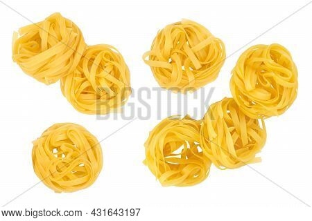 Raw Tagliatelle Pasta Isolated On White Background. Top View. Flat Lay. Set Or Collection