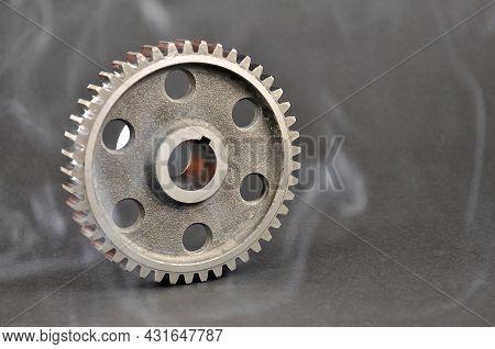 Engine Parts. Metal Cogwheel On A Dark Background. Spare Parts.