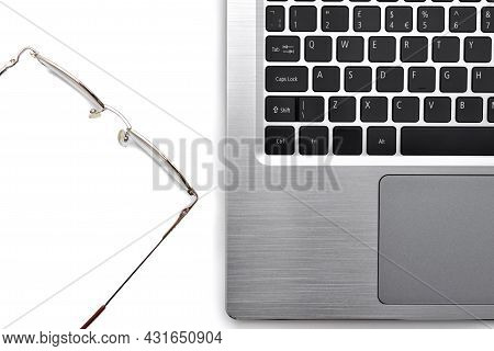 Glasses And Laptop Computer Keyboard. Vision Problems At Work With Computers. Eye Health When Workin