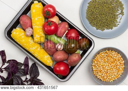 Vegetables On Pallet, Swing Of Yellow Corn, Tomatoes, Potatoes. Corn Grains And Mung Bean In Plates.