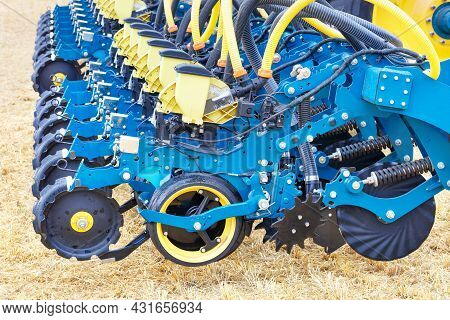 Blue Modern Multi-row Planter, Wheels, Distribution Pipes And Working Mechanisms Of Pneumatic Agricu
