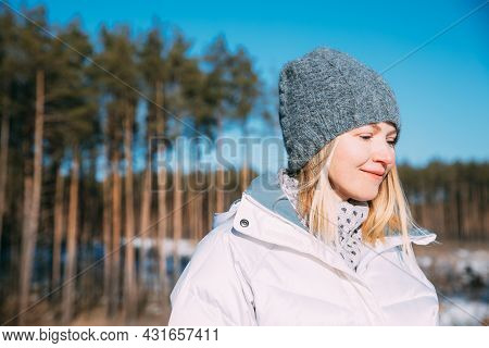 Young Beautiful Pretty Caucasian Girl Woman Dressed In White Jacket And Grey-blue, Gray Hat Smiling