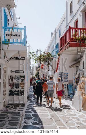 Mykonos Town, Greece - September 23, 2019: People Walking Past Shops On A Narrow Street In Hora (myk