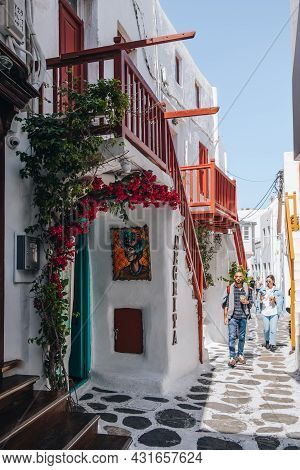 Mykonos Town, Greece - September 23, 2019: People Walking Traditional Buildings On A Narrow Street I