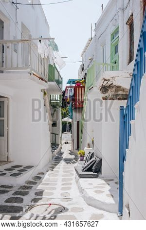 Mykonos Town, Greece - September 24, 2019: View Of An Empty Whitewashed Buildings On A Narrow Street