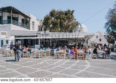 Mykonos Town, Greece - September 23, 2019: People At The Outdoor Tables Of A Restaurant On A Street