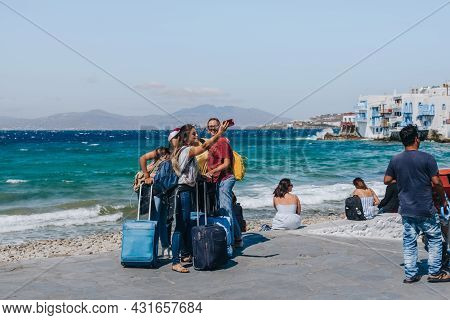 Mykonos Town, Greece - September 24, 2019: Young Female Tourists Taking Selfie By The Sea In Hora (k