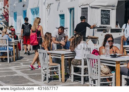 Mykonos Town, Greece - September 23, 2019: People At The Outdoor Tables Of A Restaurant In Little Ve