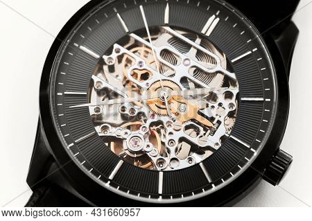 Black Wrist Watch With Skeleton Movement, Close-up Photo. A Mechanical Watch Type In Which All Of Th