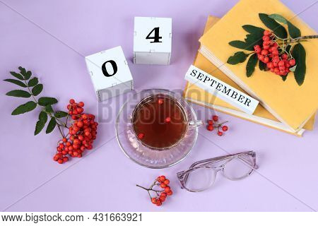 Calendar For September 4 : The Name Of The Month In English, Cubes With The Numbers 0 And 4, A Stack