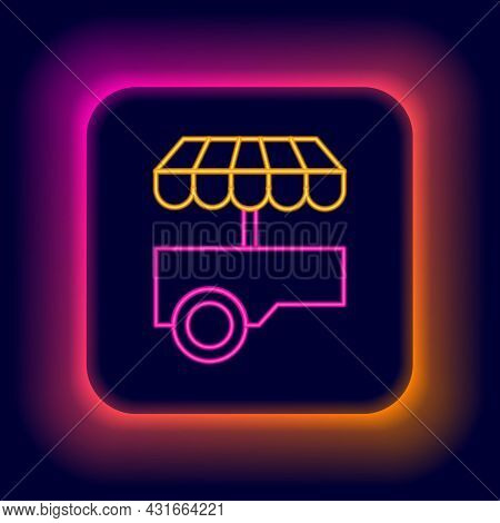 Glowing Neon Line Fast Street Food Cart With Awning Icon Isolated On Black Background. Urban Kiosk.