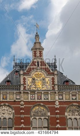 Amsterdam, Netherlands - August 14, 2021: Frontal Monumental Sculpted Red Stone Middle Facade With T