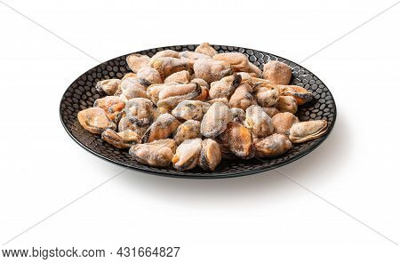 Frozen Peeled Mussels On A Black Ceramic Plate Isolated On A White Background. Cooking Shellfish. Ic