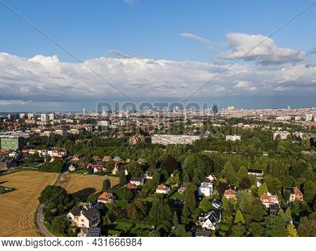 Aerial panorama view of Brussels-Capital Region and suburban area in the foreground. View from Anderlecht municipality, Cloudy and sunny day