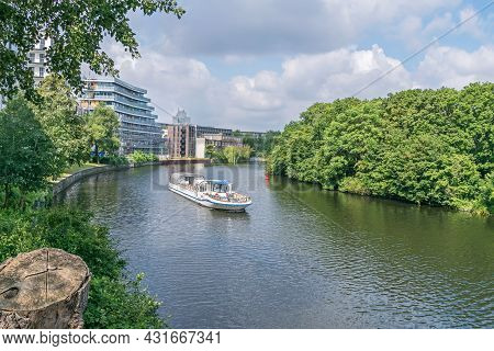 Berlin, Germany - July 3, 2021: Bank Of The River Spree Schleswiger Ufer With The Tourist Boat Maria