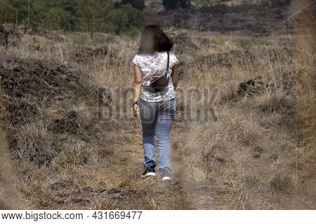 Happy Free Asia Woman Walking Alone From The Back In The Mountains Park Outdoor. Happiness And Freed