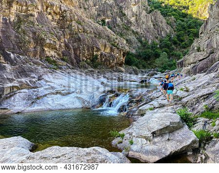 Group of Unrecognizable Peoples walking to go canyoning in Chassezac gorges