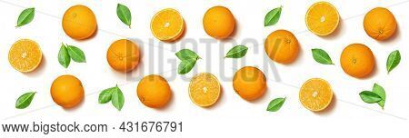 Fruit pattern arranged of oranges and orange leaves on white background. Lay out background.