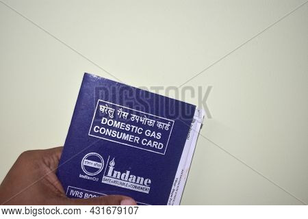 Jhargram, India; August, 23, 2021: A Domestic Gas Consumer Booking Card Of Indian Oil. Indane Gas Bo