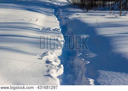 Well-trodden Path Through Deep Snow, Winter Landscape